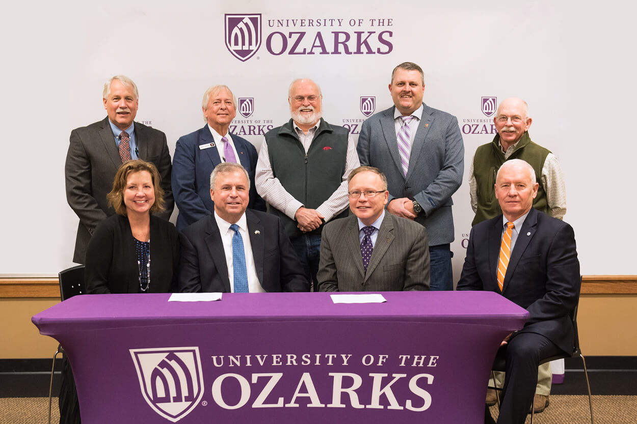 Administrators from the University of the Ozarks and Greystone Prep School
